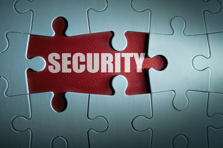 Jigsaw puzzle with missing pieces revealing the word security