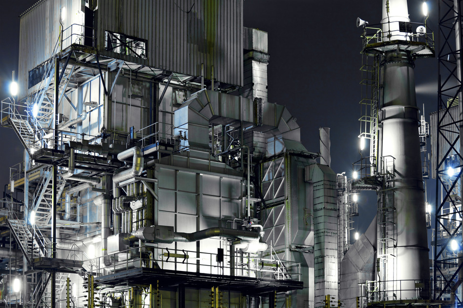 Industrial complex at night, brightly lit