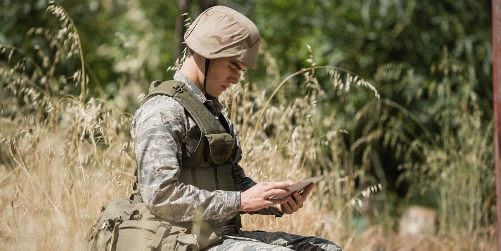 Soldier using tablet in the field
